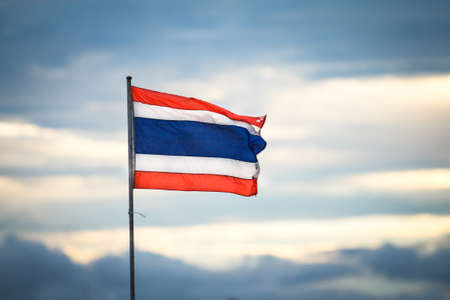 Image of waving Thai flag of Thailand with blue sky background photo