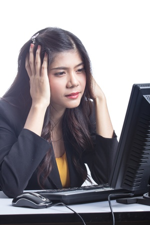 fatigued: Woman sitting in front of computer headaches.