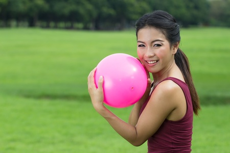 ASian Girl and pink ball for exercise photo