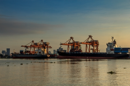 Industrial Container Cargo freight ship with working crane bridge in shipyard at dusk for Logistic Import Export background Stock Photo - 22304852