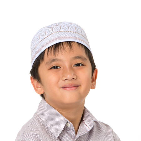 religious clothing: Islamic pray explanation. Asian child showing complete Muslim movements while praying