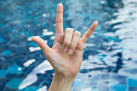 Symbol of woman hand on a pond. Stock Photo - 23722159