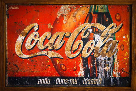 SARABURI, THAILAND- OCTOBER 30: coca-cola shield at old shop, Classic advertising Coca-cola brand in stores an old market town on October 30, 2013 in Saraburi, Thailand