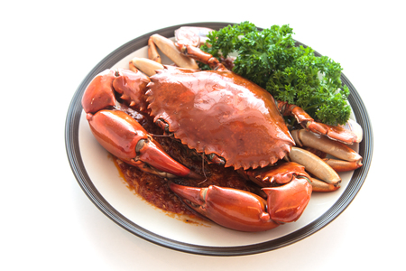 crab meat: Red crab on a plate isolated on white .