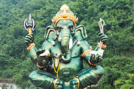 hindu god: Idol of the Hindu Elephant God Ganesha in a sitting posture Stock Photo
