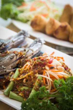 Seafood crab with spicy papaya salad, good healthy food photo