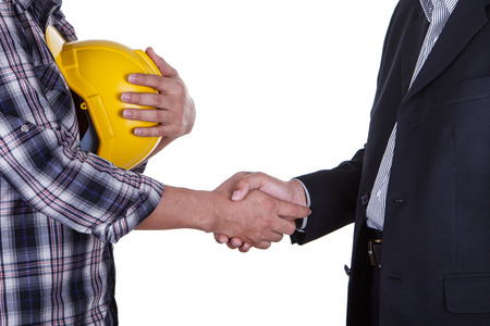 hard: Portrait of young businessman handshake with the architect. Stock Photo