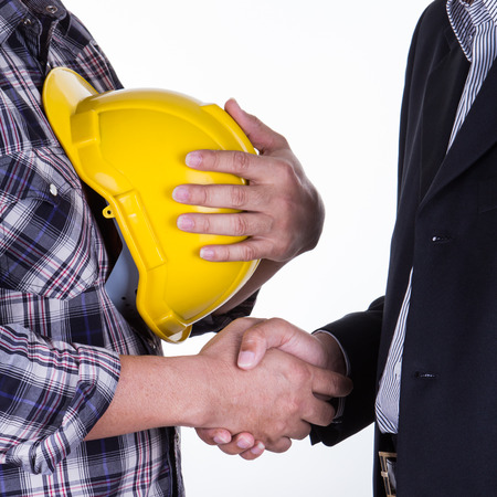 Portrait of young businessman handshake with the architect. Imagens