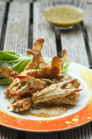 Fried crab with curry powder on a plate. photo