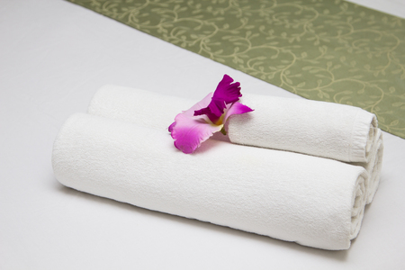luxury hotel room: Towels on bed at luxury hotel room Stock Photo
