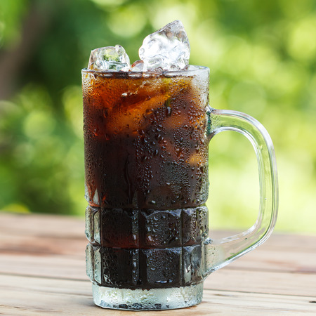 Black coffee with ice on  wooden table Stock Photo