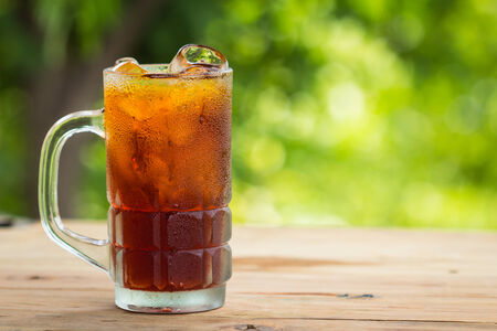 Glass of ice tea on a wooden table