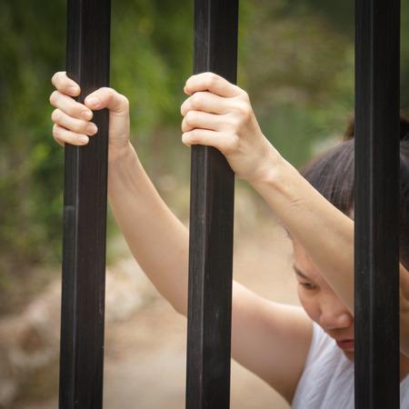 prisoner hand asking for food in jail photo