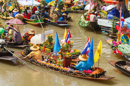 s curve: AYUTTHAYA, THAILAND - JULY 11: Beautiful flower boats in floating parade, the unique annual candle festival of Buddhist Lent Day on July 11, 2014 at Ladchado, Ayutthaya, Thailand