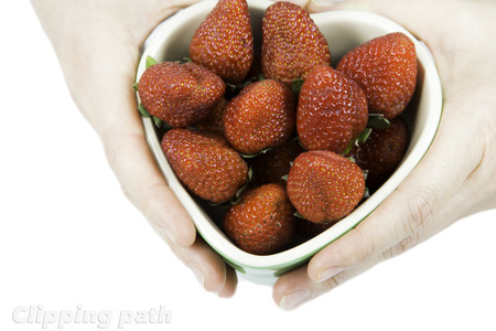 hand is holding strawberry dish with clipping path photo