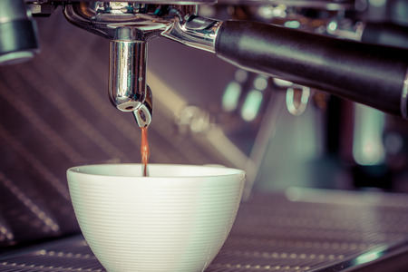 closeup making coffee in coffee machine