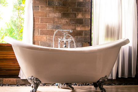 bathtub: vintage style bathroom and the view from the door. Stock Photo