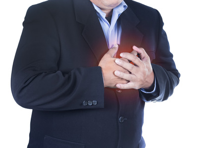 angina: businessman with heart ache on white background
