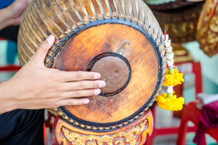Hand drumming ancient Thailand in brand