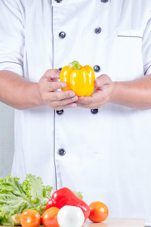 bell peper: close up chef holding bell peper in kichen