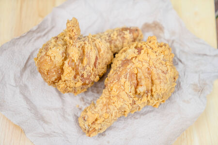 chicken fried on wooden table photo