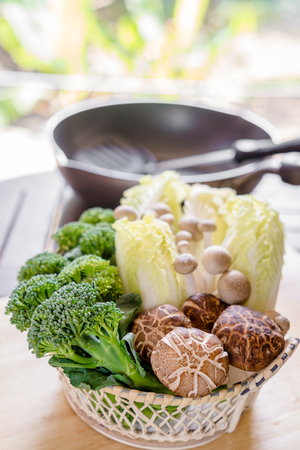 cutting bord: mushroom, lettuce, Broccoli in the basket on cutting bord