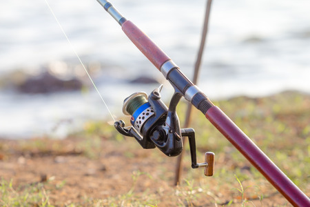 Fishing pole: Close up of fishing pole with spinning