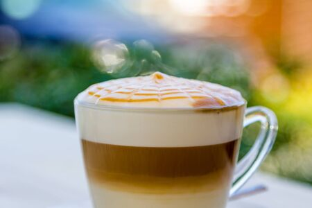 the art of coffee with milk foam on wooden table