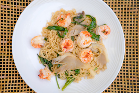 the instant noodles: Instant noodles with pork and shrimp in a plate Stock Photo