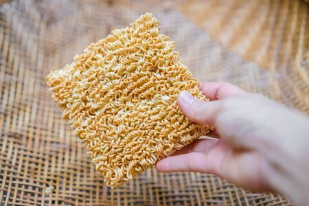 the instant noodles: Instant noodles in white plate on wooden Stock Photo