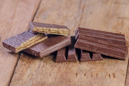 sweet segments: close up chocolate bar on wooden table