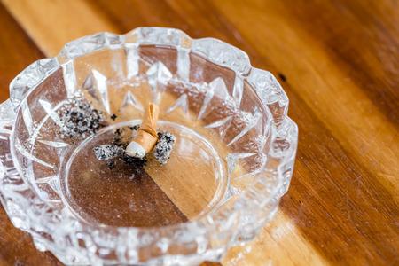 ashtray: ashtray on wooden table