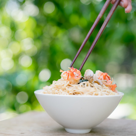the instant noodles: Instant noodles with pork and shrimp in a bowl