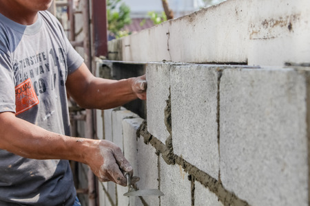 construction mason worker install bricklayer Stock Photo