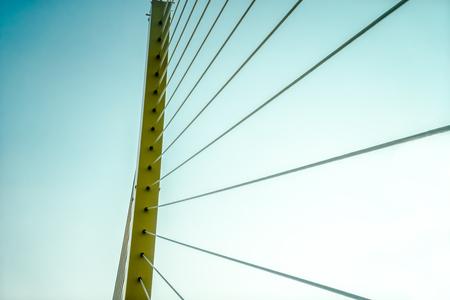 thai stretch: close up rope bridge with retro sky