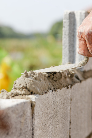 bricklayer: construction mason worker install bricklayer Stock Photo