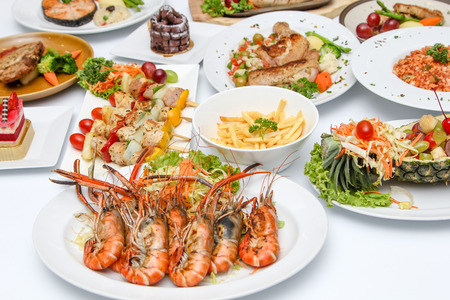 international food: Grilled Shrimp  and many food on dining table