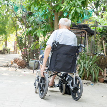 physical impairment: old man in a wheelchair