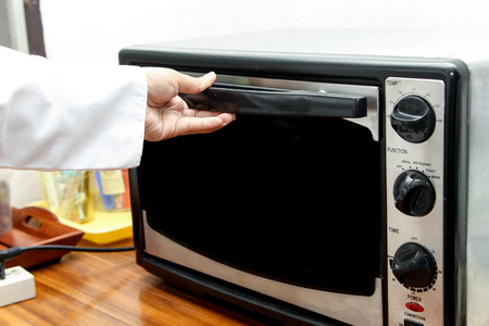 defrost: chef useing oven for cooking in the kitchen