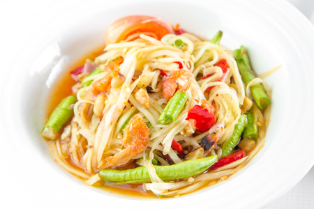 green papaya salad: Spicy green papaya salad and roast chicken.