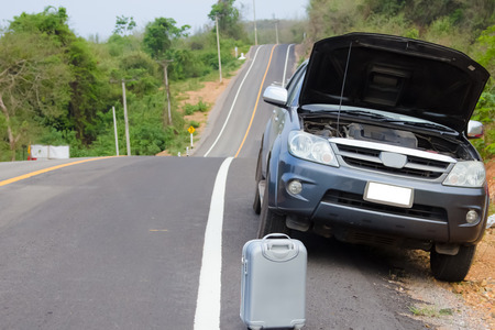 gass: Broken down car on the side of a road Stock Photo