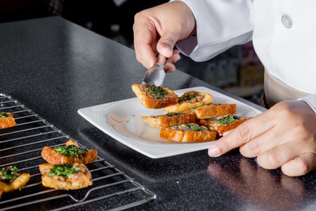 fried food: chef making bread with minced pork spread Stock Photo