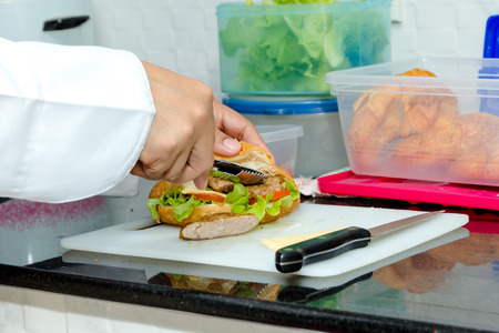 gill: chef making croissant with gill pork, vegetable and cheese Stock Photo