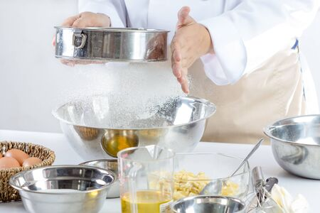 sift: sifting flour for making bakery in kitchen room Stock Photo