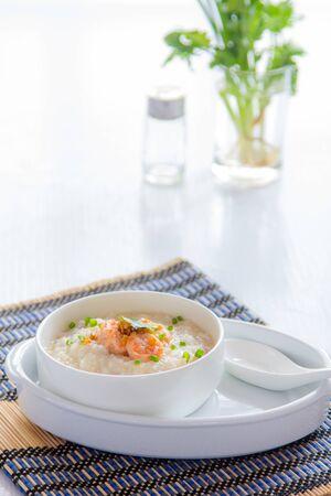 rice porridge with shrimp, squid on white table