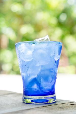 spilt: ice in blur glass