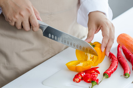 bell peper: chef slicing bell peper for cooking