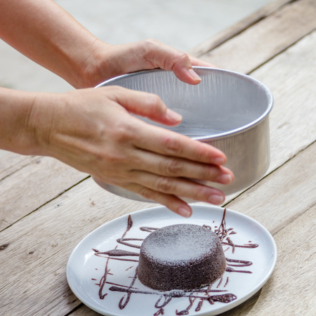 molted: Dark chocolate lava cake with Icing sugar in plate Stock Photo