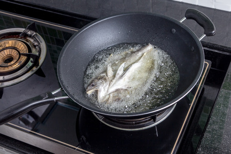 fried fish and oil in fried pan