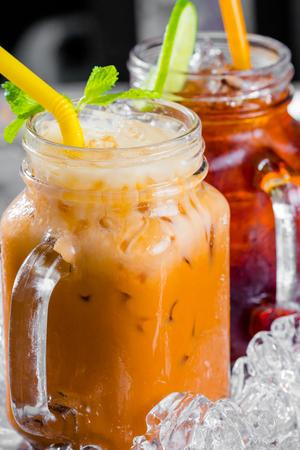thai decor: thai ice tea with milk and lemon tea in pitcher